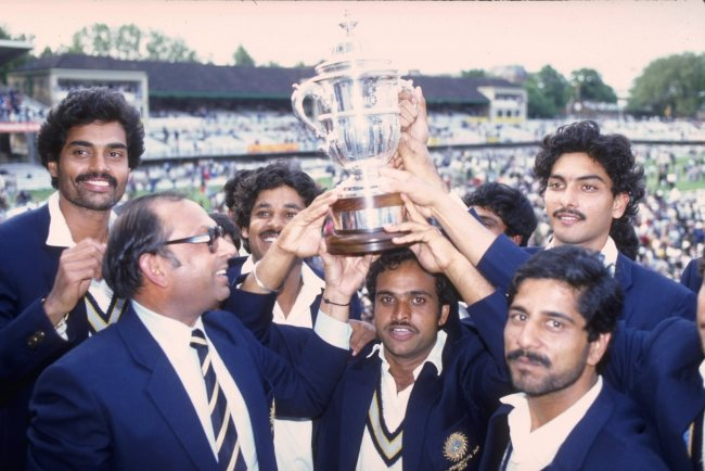 25 June 1983, India lifting the World Cup. Notice Ravi Shastri and his unkempt hair.